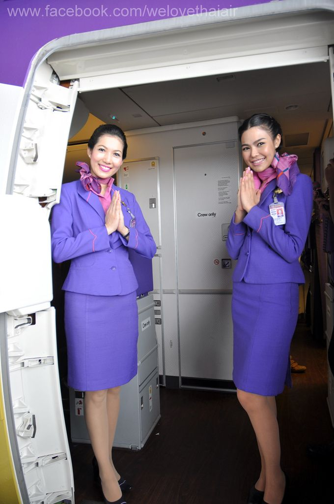 "Thai Airways International Cabin Crew welcoming Australian police officers on board after their flight from Bangkok touched down in Sydney. They have successfully restrained an agitated passenger who attempted to gain entry to the cockpit. ""We have tied him up"" the hostess on the right explains. ""He is very apologetic now."""
