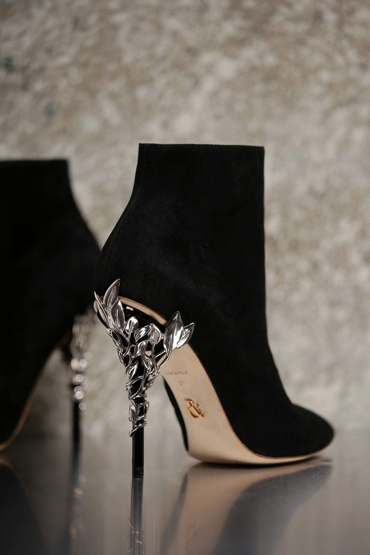 <p>With ornamental filigree leaves spiralling naturally up the heel, this Black Suede Eden Ankle Boot harks back to the beauty and perfection of a lost paradise. As if from an enchanted fairy-tale, entangled in the dense foliage of the forest and claimed by a wandering damsel, the Eden Ankle Boot is celestial, refined and romantic.</p><p>The Eden Ankle Boot is part of an exclusive preview of our new accessories collection, as featured in the AW16/17 Couture Show. For more information about…