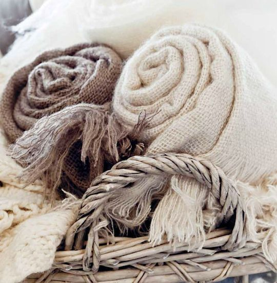 Soft white and taupe throws, pale grey wicker basket
