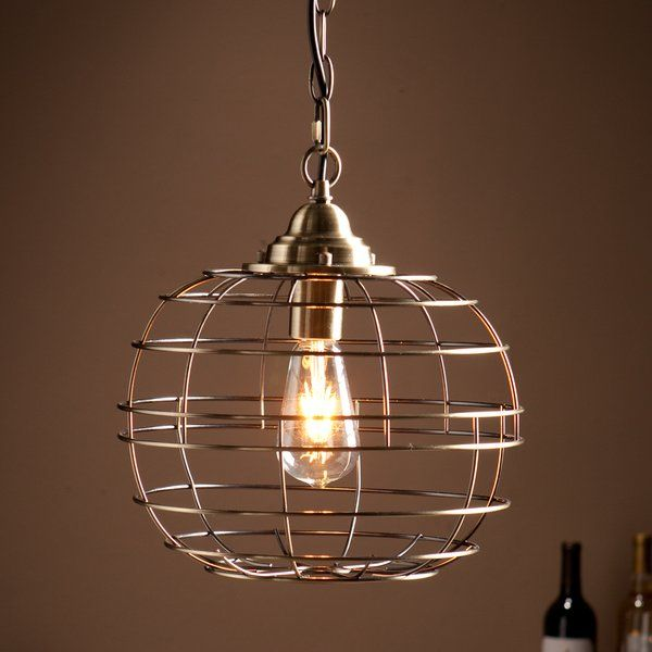 Round out your lighting scene with this pendant light. The cage styled, rounded shade is finished in an antique bronze hue, nodding at its industrial age inspiration. Inside is an on trend Edison styled LED bulb, and the suspension chain completes the ruggedly chic appearance. This contemporary chandelier will add the perfect amount of light and style to your entryway, living area or dining room. Installation by a professional electrician is recommended.