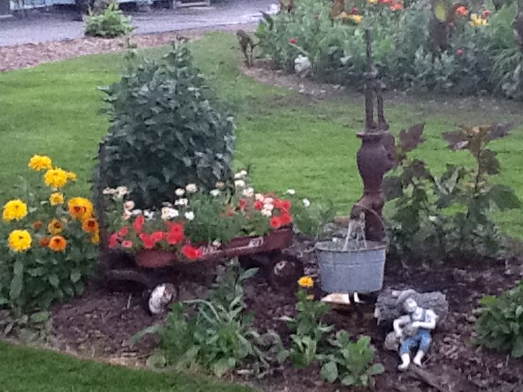 Old pump water feature beautiful flowers pinterest for Yard pond pumps
