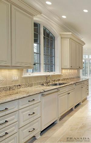 Classic / Traditional kitchen. Antique white with dishwasher panel, granite countertops, decorative kick. www.prasadakitchens.com by oldrose