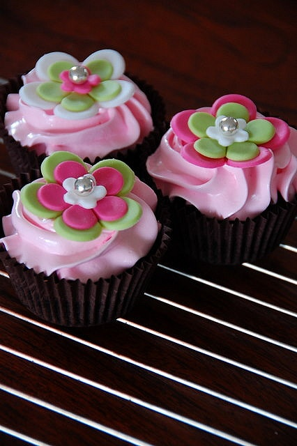fondant flower cupcake toppers. Can do in two different colors, white and light brown, with a pearl in the center.