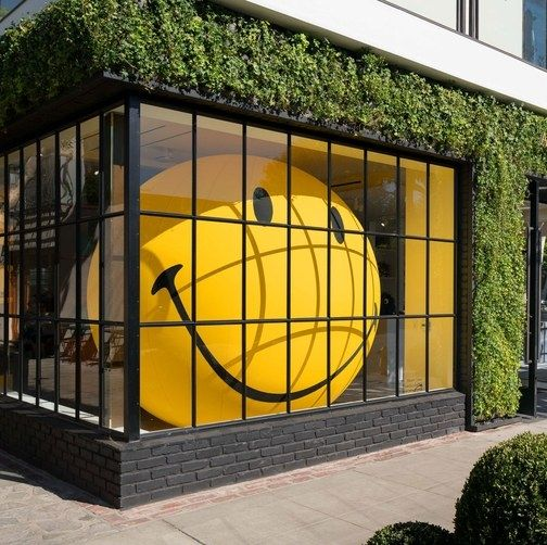 A blow-up smiley face in the window at Anya Hindmarch's new L.A. store | archdigest.com