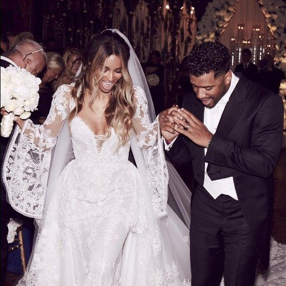 Singer Ciara married her NFL player partner Russell Wilson in a gorgeous, custom-made Roberto Cavalli gown complete with amazing, lace bell sleeves. The beautifully boho gown even featured the couple's initials embroidered into the lace on the back of the dress. The couple chose to marry in Cheshire, picking Peckforton Castle as the setting for their dream day.