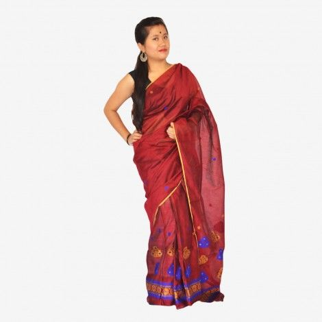 Assamese Traditional Mekhela Chador__ Shop on OnlinePlus______Padmini Maroon Color Tagar Mekhela Chador Set with Blouse Piece- The flawless beautiful Padmini Maroon color Mekhela Chador gives a very classy look in itself, and when it comes for design, it is the elegant flowers that is chosen. This Mekhela Chador is a very good outfit for parties and occasions.