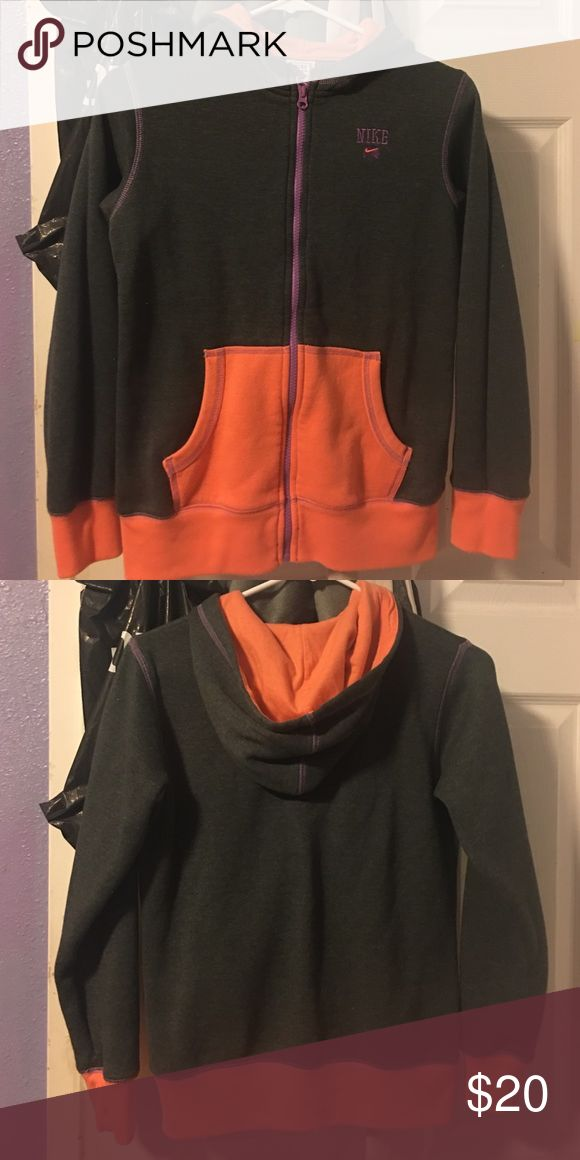 Nike zip up sweater Nike zip up sweater, bright orange, and some purple detail (big kid Large, so fits like woman small) Nike Jackets & Coats