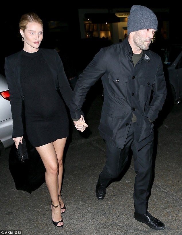 Heading home:Rosie added a black jacket on top with coordinating heels, which featured a ...