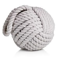 Being reminiscent of beachcombing finds and fishing boats, this outsized knot of rope, with its simple looped handle, makes the perfect bathroom doorstop. It will suit minimal, neutral, and nautical bathroom decor schemes. To clean, wipe with a soft damp cloth and when not in use, place in a safe position to prevent tripping. Colours, specifications and designs may vary due to the nature of the product. Take care when placing on polished, painted or synthetic surfaces.
