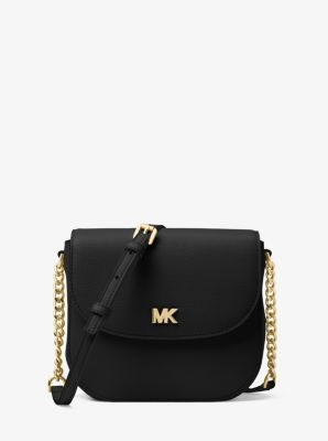 4221d304d345ec Constructed from pebbled leather in a dome-shaped silhouette, this Mott  crossbody boasts on