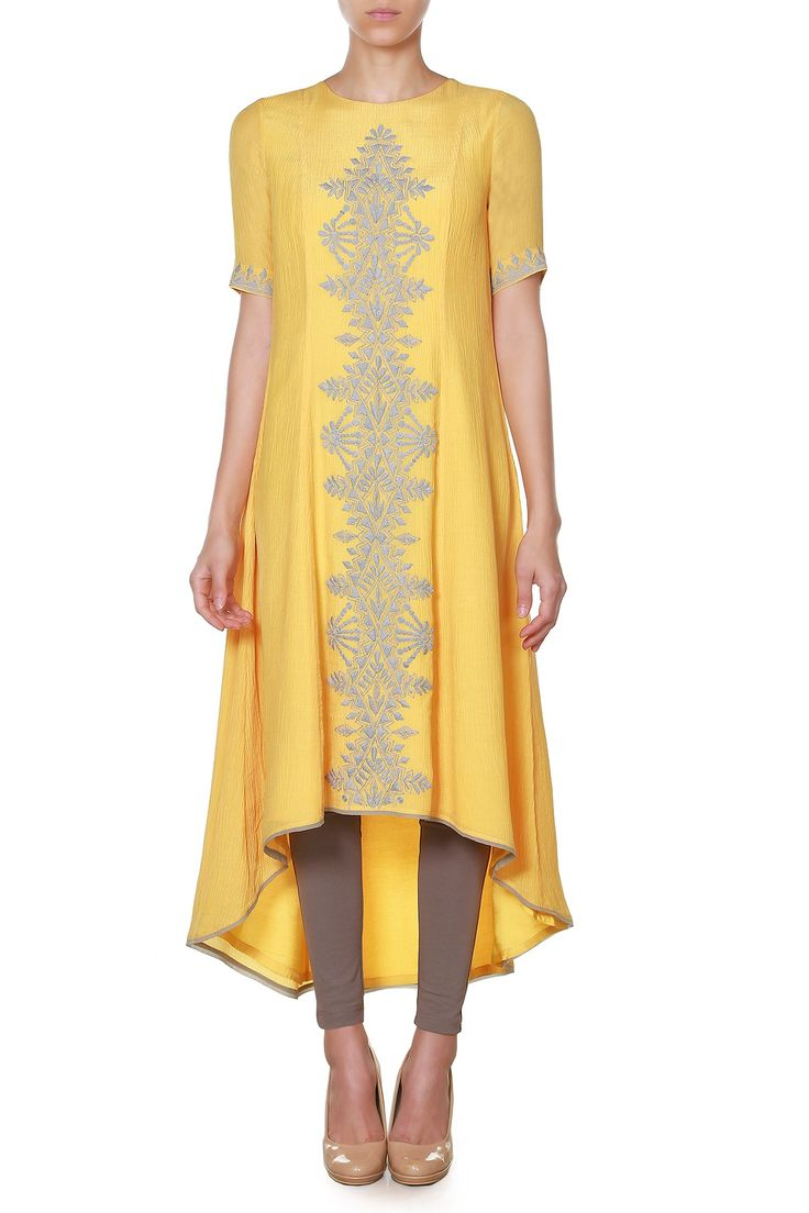 Presenting a cascading tunic in warm, sunshine yellow embellished with detailed dori embroidery in the front. This piece goes best with stone-coloured jeggings and nude pumps.INR 8,990.00
