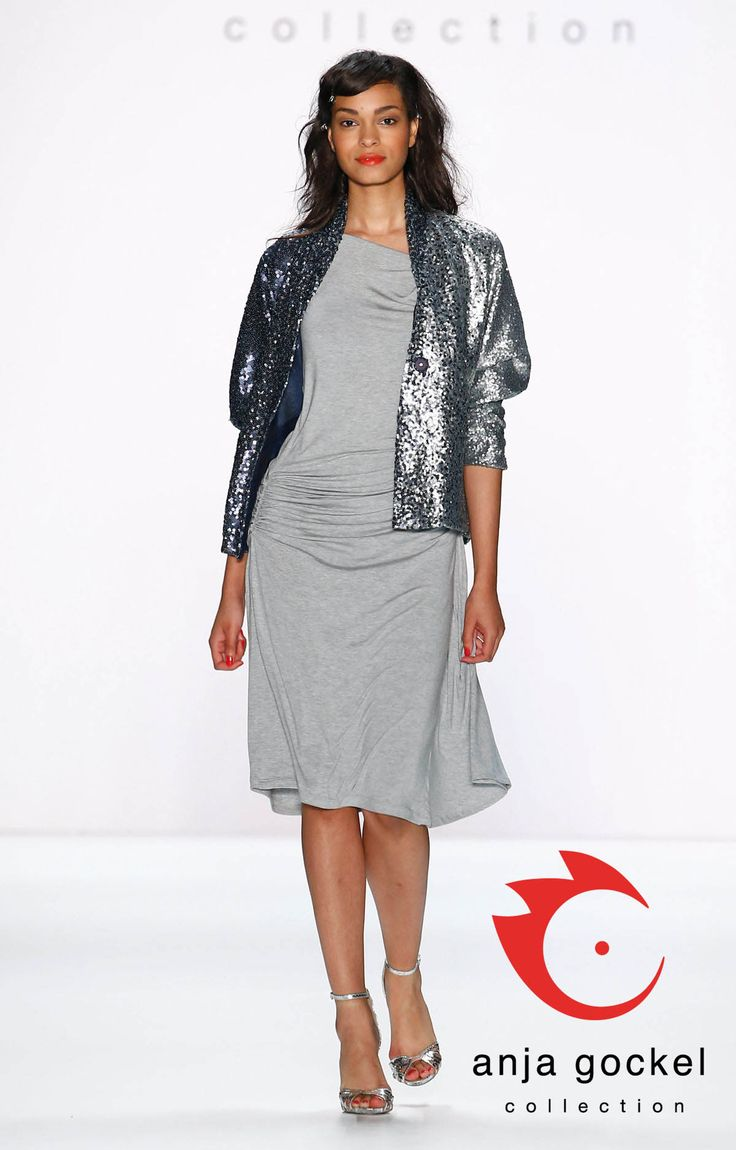 Mid-length grey jersey dress with charming drappings which perfectly plays with every female bodyshape is teamed with a glamorous jacket with puffed sleeves consisting of a great silver-blueish gradient sequin fabric.