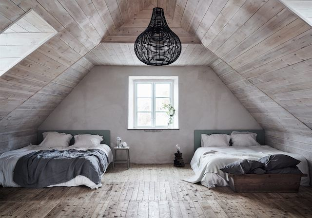 Guest bedroom in the eaves of a   Swedish island retreat.