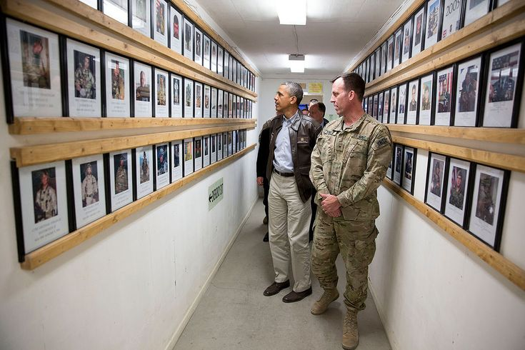 President Barack Obama and Brig. Gen. Erik Kurilla view photos of fallen military personnel at Bagram Airfield, Afghanistan, Sunday, May 25, 2014. (Official White House Photo by Pete Souza)   This official White House photograph is being made available only for publication by news organizations and/or for personal use printing by the subject(s) of the photograph. The photograph may not be manipulated in any way and may not be used in commercial or political materials, advertisements, emails…