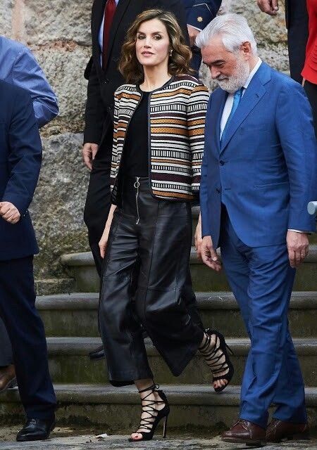 Queen Letizia of Spain attends the opening of the 11th International Seminar on Language and Journalism 'The language of humor in journalism in Spanish' at the Monastery of Yuso on May 25, 2016 in San Millan de la Cogolla, Spain. Queen Letizia of Spain attends the opening of the 11th International Seminar on Language and Journalism. Letizia wore Uterque Coat, Leather Trouser and Sandals