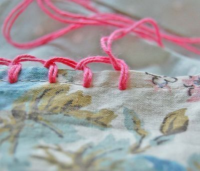 Blanket stitched edge with sewing needle and thread - add your crocheted edge to the blanket stitch. WHO KNEW crocheting edging on pillow cases was so easy! Thank you to this charming blogger!