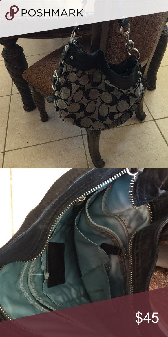 Large coach purse Grey and black coach purse outside is in good shape no stains tears inside has marks throughout price reflects that may be able to clean Coach Bags Hobos