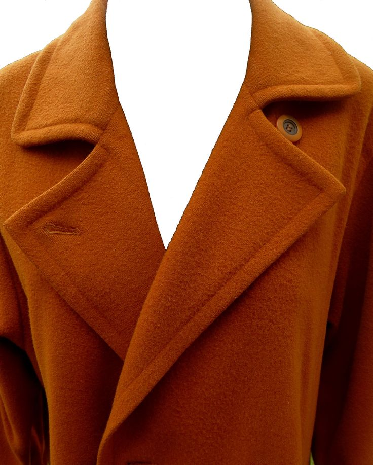 A light pure wool European coat in a lovely rust colour. Full lining with lovely finishes, slightly worn.