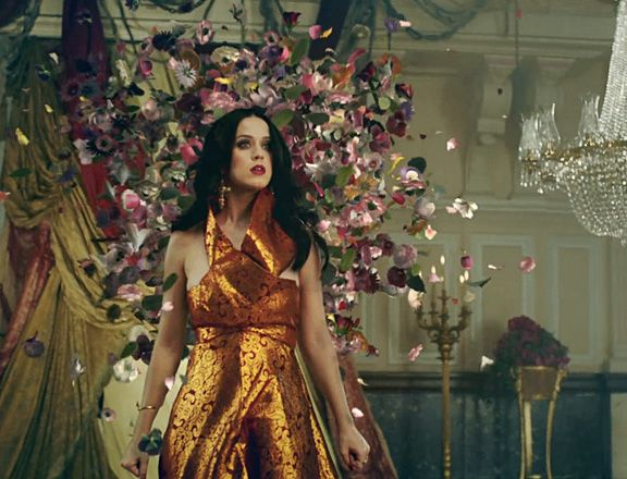 I want this gold halter top dress from Katy Perry's Unconditionally video!!! ~Abi Moore