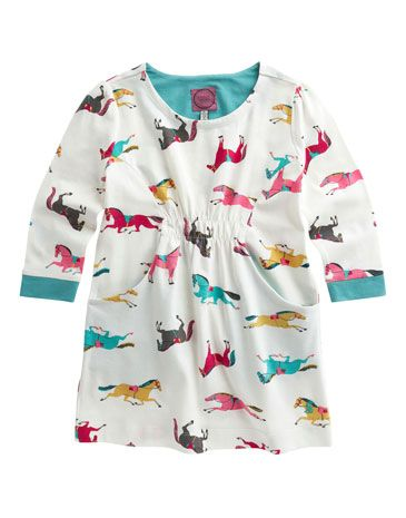 Joules JNR LISSY Girls Printed Long Sleeved Tunic, Creme Pony. This long sleeved tunic is perfect to brighten up the greyest of days. With an elasticated waist to give it a shaped fit and in comfy cotton jersey.