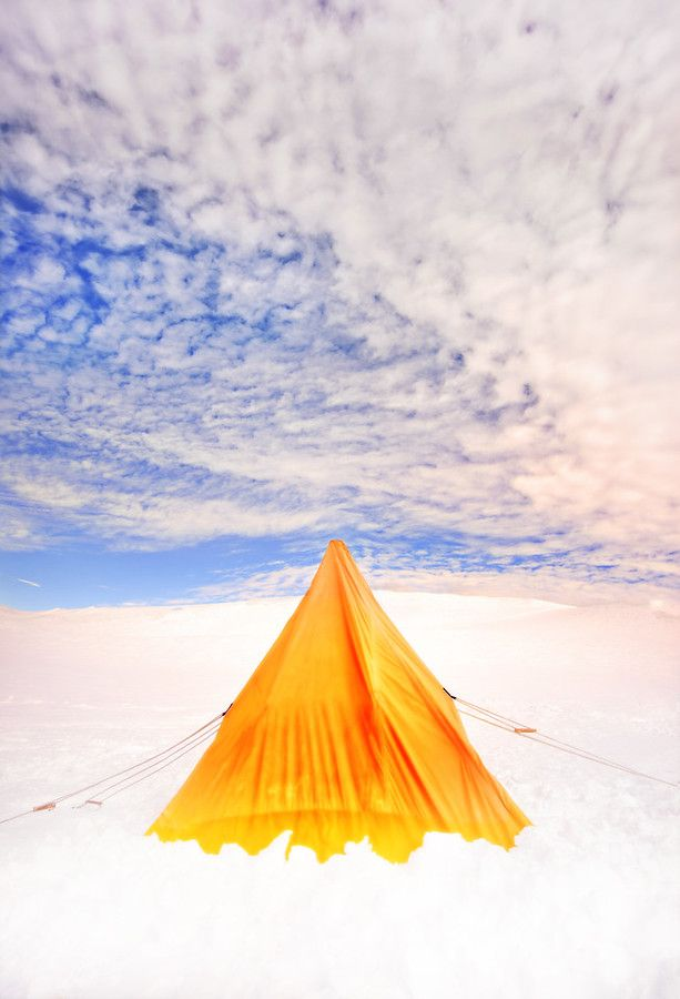 One day in survival training, Stu and I had to erect our own tent. It was awesome. It's not exactly a normal tent — I believe they are called polar tents. They are built to withstand blizzard conditions. You can imagine a normal tent in a blizzard… that just wouldn't work. - Antarctica - Photo from #treyratcliff Trey Ratcliff at http://www.StuckInCustoms.com