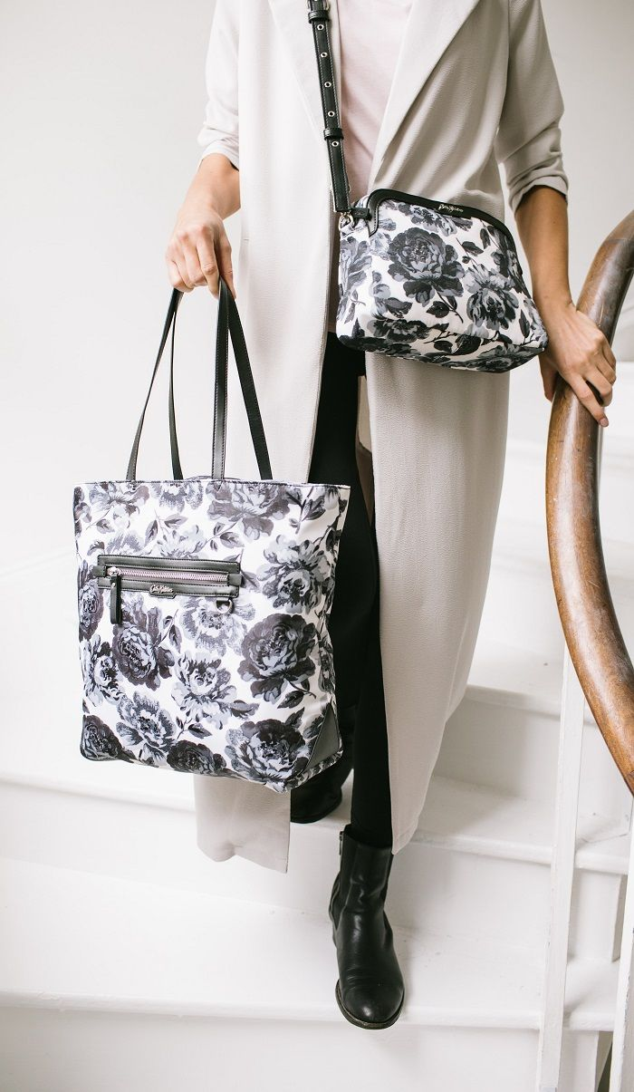8ae7d8ee2702 Have you seen our new Peony Blossom bags  Fashion forward black and grey  florals on a cross body and tote bag for daily essentials.