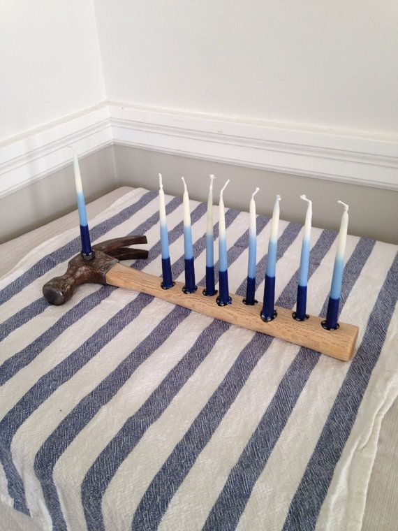 This menorah, made from a recycled hammer, is arguably the most unique and certainly the most multi-functional Hanukkah menorah you can buy.