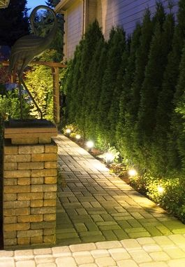 Landscape lighting ideas to safely illuminate a garden pathway #landscaping #backyard #walkway