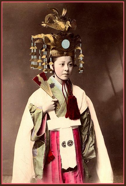 "A Miko of old Japan. Miko, or ""shrine maidens"", are women that perform Kagura (Shinto theatrical dances)."