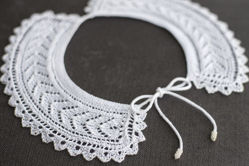 Lace collar knit with Size 8 DMC pearl cotton on Size 0 needles.  Pattern adapted from an 1846 pattern booklet entitled The Knitted Lace Collar Receipt Book, written by Mrs. G.J. Baynes of Gravesend.