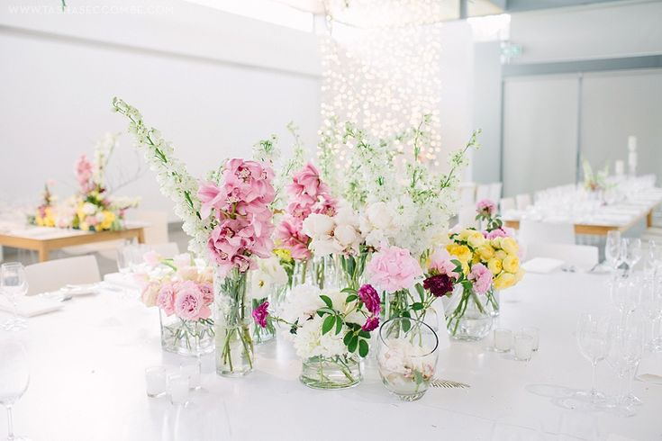 Charming table arrangements we did for Jana and Nikki. Photo by Tasha Seccombe