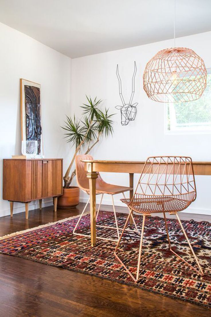 So, you are a really big fan of geometric art? Go all the way with a geometric deer head on your wall (order it at the DotSan shop on Etsy). It will combine perfectly with retro chairs by Smart Furniture and ditto lampshades.