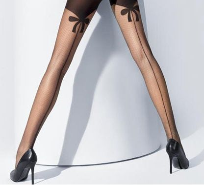 Nude and Black Secret Bows Tights. Sheer nude tights with an all-over, subtle black diamond pattern, black back seam that runs up the centre of the leg and bow design at a seductive stay-up height. The tights are finished with an opaque pants section. By Wolford - lingerie online sites, adult lingerie online, body lingerie