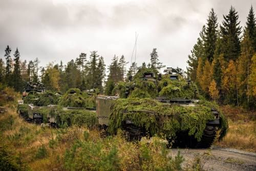 Fully camouflaged Norwegian CV9030N participating in the large scale international Exercise Noble Ledger