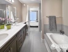 Master ensuite. Soaker tub, ceramic tile, double vanities, quartz counter. Luxury 3 bedroom townhomes. The Intrigue model, by Kimberley Communities.