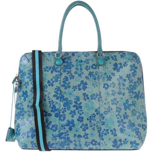 Gabs Handbag ($160) ❤ liked on Polyvore featuring bags, handbags, turquoise, floral handbags, leather hand bags, leather man bag, blue leather purse and genuine leather handbags