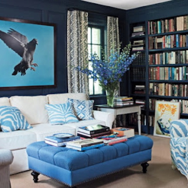 blue living room or den ideas love the eagle against the blue sky on the wall plus the blue zebra chair