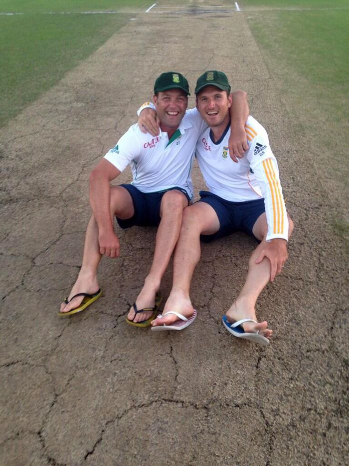Jacques Kallis and Graeme Smith relax on the Kingsmead pitch, South Africa v India, 2nd Test, Durban, 5th day, December 30, 2013
