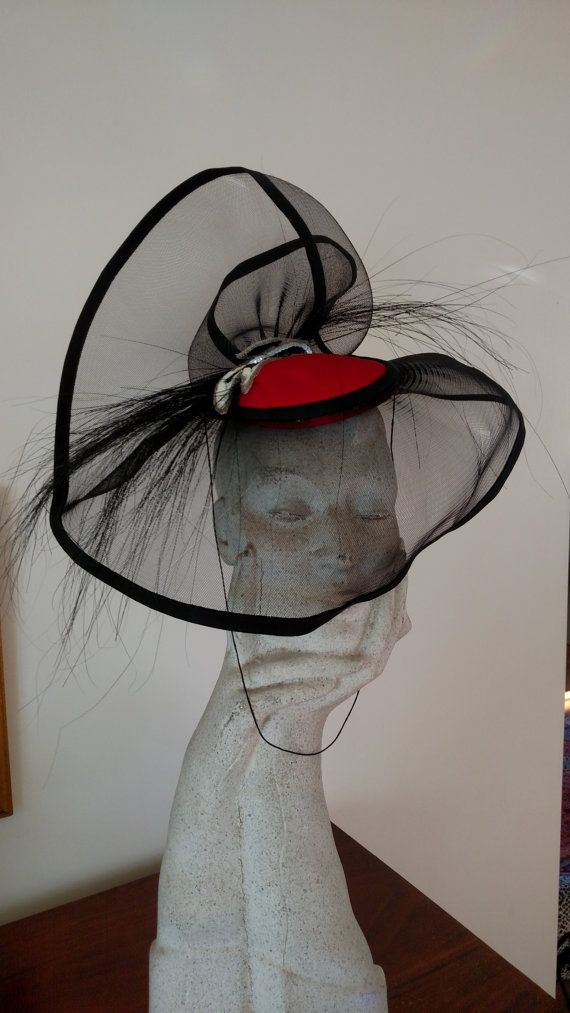 Check out this item in my Etsy shop https://www.etsy.com/listing/276436994/sonni-san-francisco-veiled-fascinator