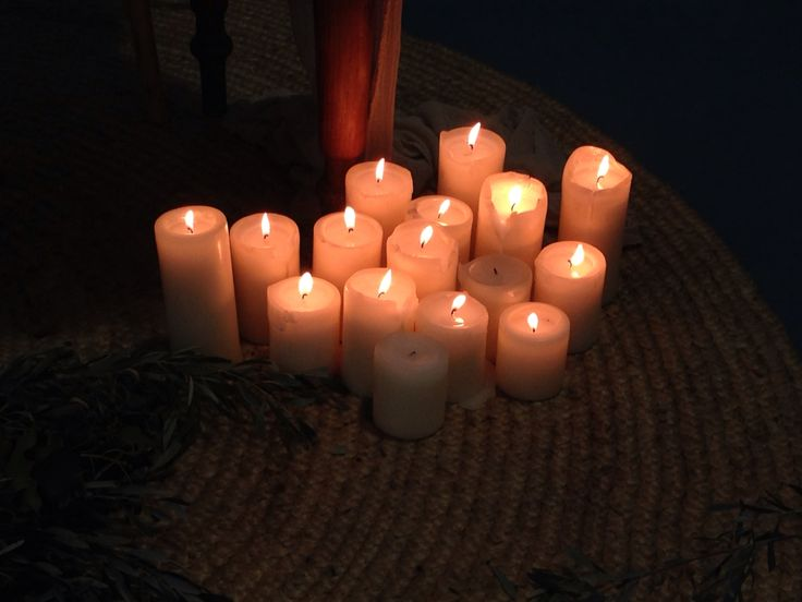 Multilevel candles for near cement wall in reception area at oaks