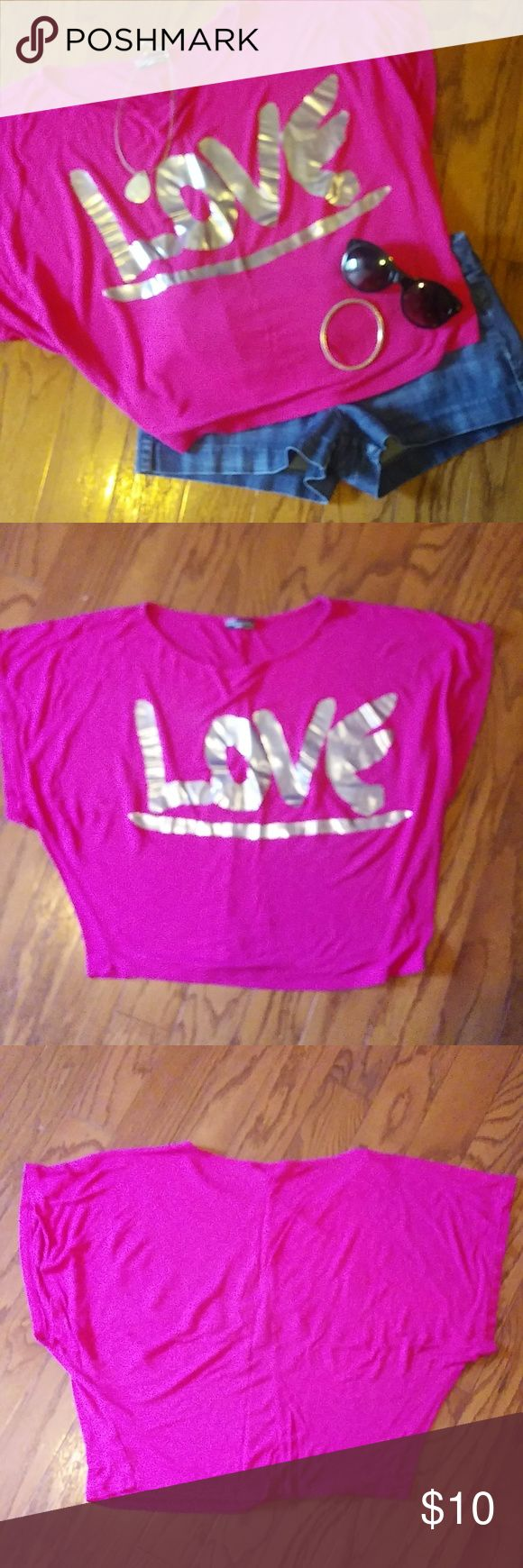 Body Central pink top Pink Body Central top with the word LOVE embellished in silver. Body Central Tops Crop Tops