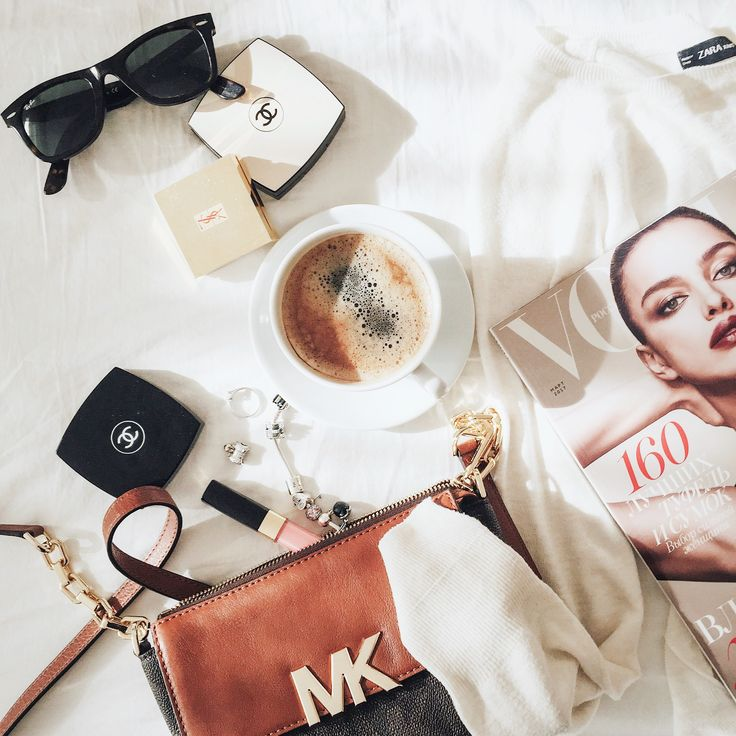Flatlay with coffee, vogue magazin, Michael Kors bag and Chanel cosmetics
