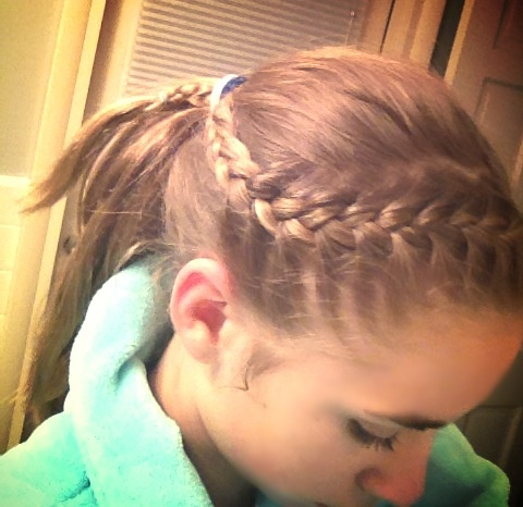 a tight french braid into a ponytail great for playing