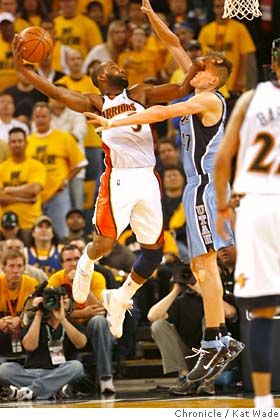 Baron Davis plants his forearm in Kirilenko's face and plants the ball firmly in the basket. One of my favorite dunks of all time.