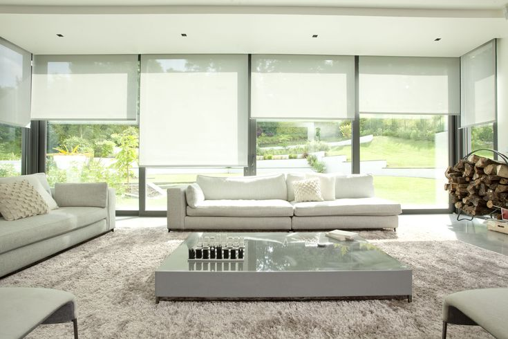 Beautiful roller blinds provide great versatility to this room.