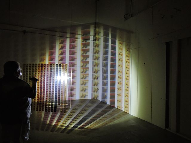 Jennifer West, 'Flashlight Filmstrip Projections' (2014) (photo by the author for Hyperallergic)