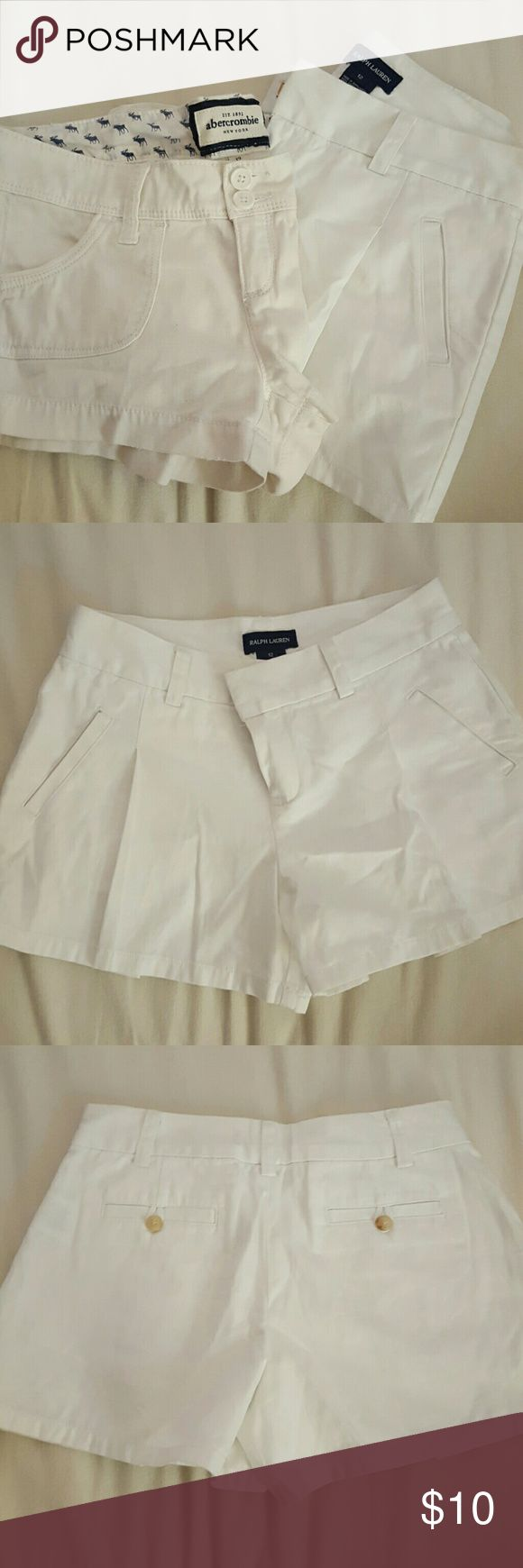 Girls shorts 1 white Ralph Lauren girls shorts size 12.  RL shorts have one pleat on each leg and shirts almost resemble a tennis skirt.  1 pair of off-white Abercrombie girls shorts  (short shorts) . Both gently used. Ralph Lauren Bottoms Shorts