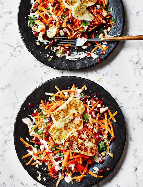Cashew, carrot, pomegranate and halloumi salad - this salad recipe from Alice Liveing is crunchy and fresh, perfect for summer evenings.