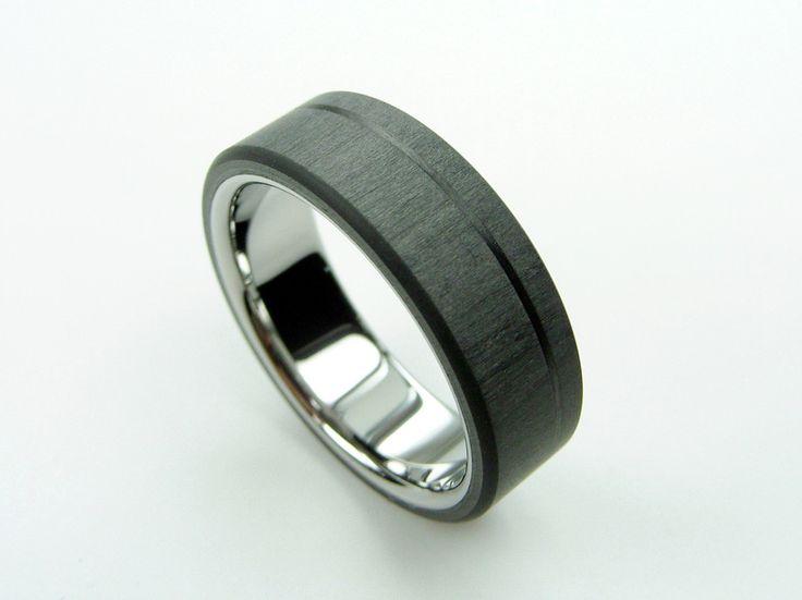 Carbon Fiber and Titanium ring -- Pinstripe http://hersteller.myshopify.com/products/carbon-fiber-and-titanium-ring-pinstripe