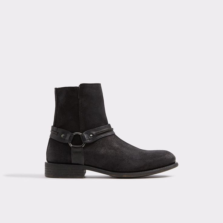 Asuwen Topped with equestrian inspired hardware this rugged styles stands somewhere between a work and biker boot. Available in distressed leather and suede, it's perfect for the urban cowboy in us all.